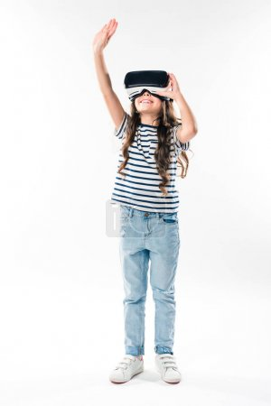 Photo for Child watching something in virtual reality headset and touching with hand isolated on white - Royalty Free Image