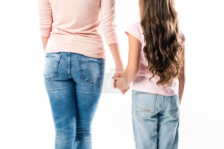 Photo for Cropped image of mother and daughter walking holding hands isolated on white - Royalty Free Image