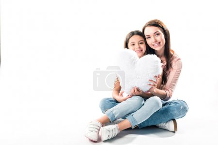 Mother and daughter with heart shaped pillow