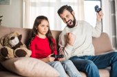 father screaming and winning daughter in video game