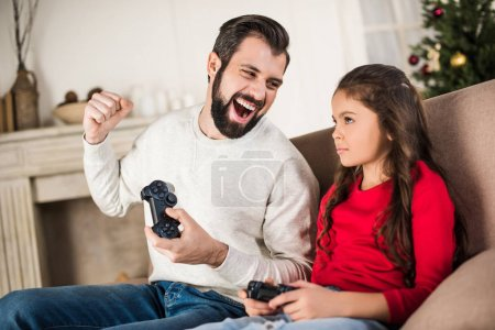father winning daughter with video game