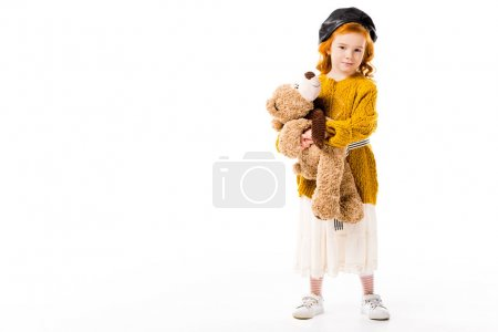 red hair child standing with teddy bear isolated on white
