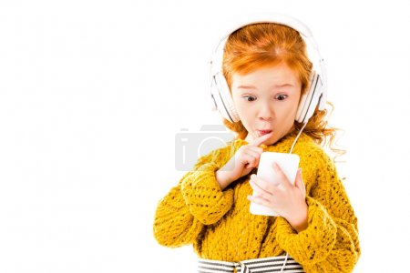 Photo for Red hair kid looking with surprise at smartphone isolated on white - Royalty Free Image