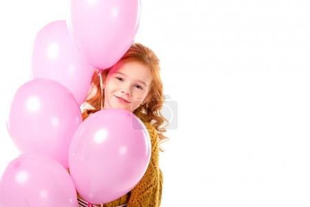 Photo for Red hair child standing with bundle of pink balloons isolated on white - Royalty Free Image