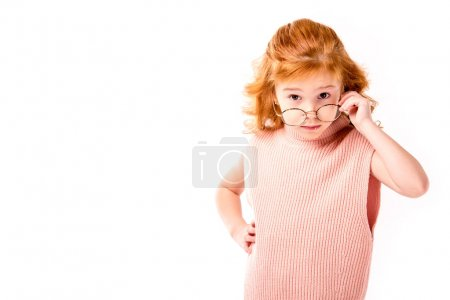 red hair kid looking above glasses isolated on white