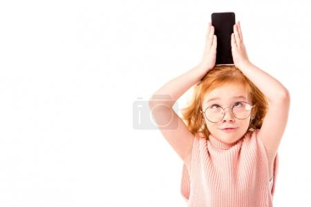 funny red hair kid holding smartphone on head isolated on white