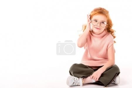 Photo for Kid with ginger hair talking by smartphone on white - Royalty Free Image