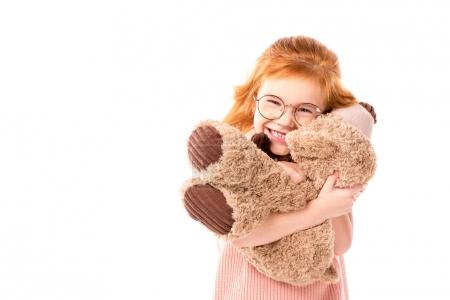 Photo for Red hair kid hugging teddy bear isolated on white - Royalty Free Image