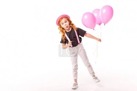 Photo for Grimacing red hair kid standing with pink balloons on white - Royalty Free Image