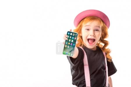 Photo for Stylish kid in pink hat and suspenders showing smartphone with programs icons isolated on white - Royalty Free Image