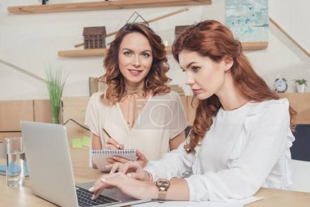 Photo for Beautiful young businesswomen working together at office - Royalty Free Image