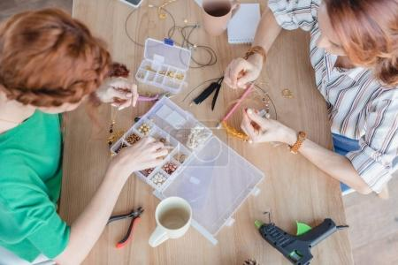 Photo for High angle view of young women in handmade accessories workshop - Royalty Free Image