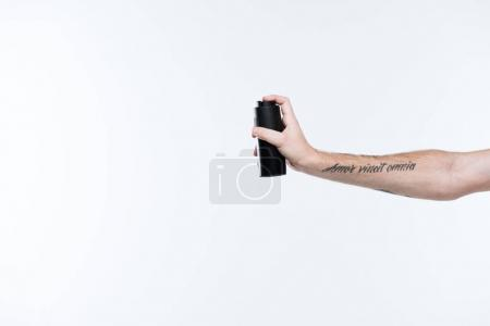 Cropped image of tattoed hand with deodorant spray, isolated on white