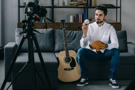handsome sport blogger recording new video about baseball