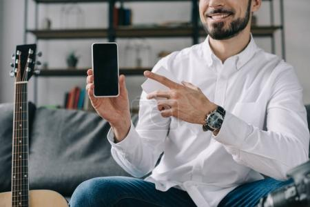cropped image of technology blogger pointing on new smartphone