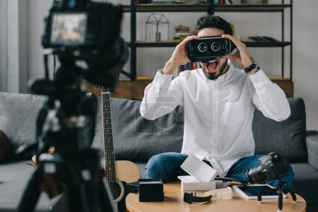 surprised technology blogger testing virtual reality headset
