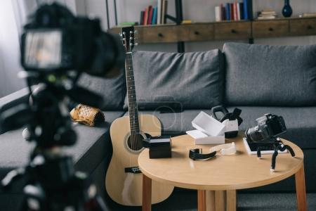 acoustic guitar and cameras in empty room