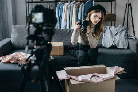 young fashion blogger recording video about dress for new vlog