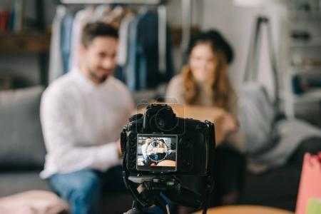 fashion bloggers sitting with box in front of camera