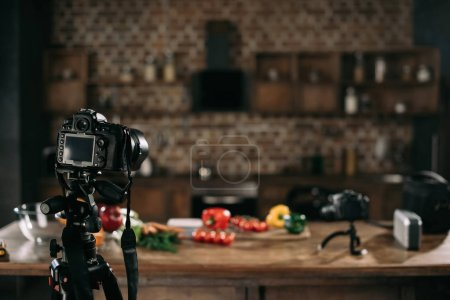 cameras and vegetables on table for food blog