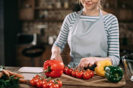Photo for Cropped image of cook cutting cherry tomatoes - Royalty Free Image