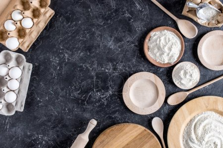 flay lay with arranged bread bakery ingredients and kitchenware on marble tabletop