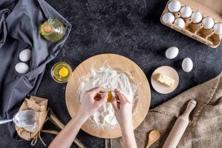 Photo for Cropped shot of woman mixing ingredients for baking bread - Royalty Free Image