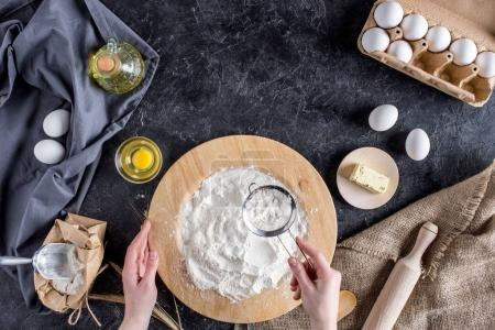 cropped shot of woman mixing ingredients for bread