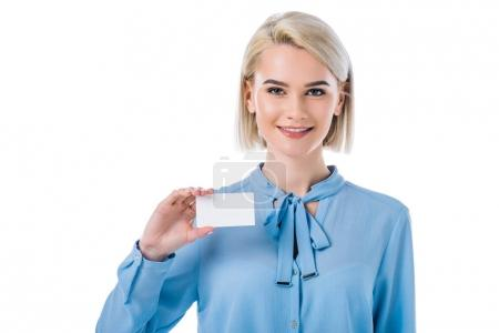 Photo for Portrait of smiling woman showing empty card in hand isolated on white - Royalty Free Image