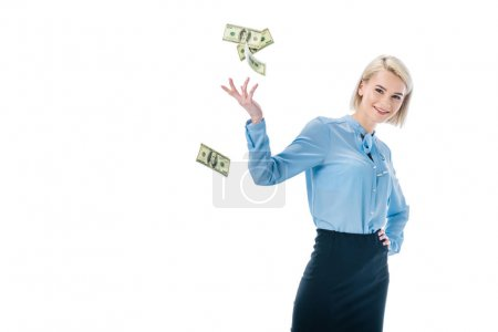 cheerful elegant businesswoman throwing dollar banknotes, isolated on white