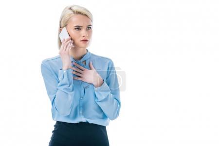 beautiful shocked businesswoman talking on smartphone, isolated on white