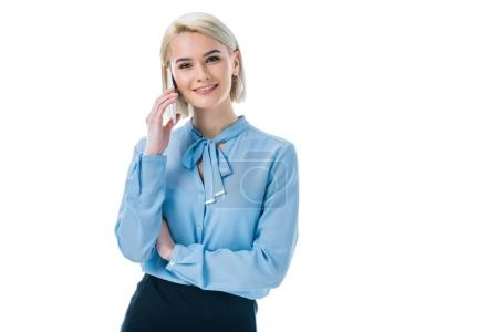 Photo for Beautiful smiling businesswoman talking on smartphone, isolated on white - Royalty Free Image