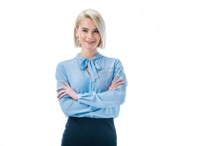 beautiful smiling businesswoman posing in formal wear with crossed arms, isolated on white