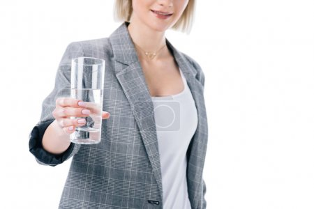 Photo for Cropped view of woman holding glass of water, isolated on white - Royalty Free Image