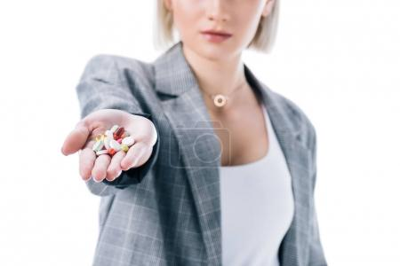 cropped view of woman holding pills in hand, isolated on white