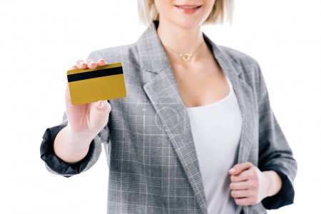 cropped view of businesswoman presenting golden credit card, isolated on white