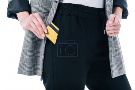 cropped view of businesswoman with golden credit card in pocket, isolated on white