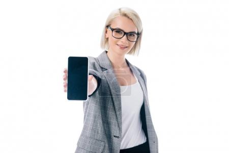 businesswoman presenting smartphone with blank screen, isolated on white