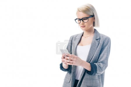 attractive businesswoman in formal wear using smartphone, isolated on white