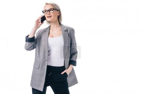 Photo for Cheerful stylish businesswoman talking on smartphone, isolated on white - Royalty Free Image