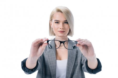attractive blonde woman holding eyeglasses, isolated on white