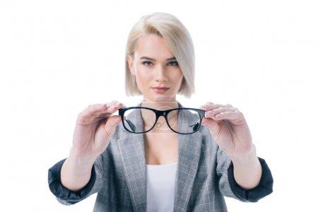beautiful blonde woman holding eyeglasses, isolated on white
