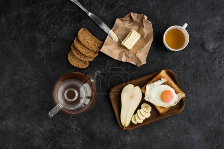 flat lay with tasty healthy breakfast on dark tabletop