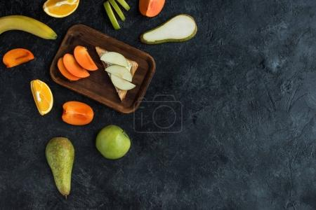 Photo for Flat lay with ingredients for healthy breakfast on dark tabletop - Royalty Free Image