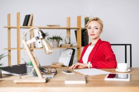 Photo for Portrait of beautiful businesswoman at workplace in office - Royalty Free Image