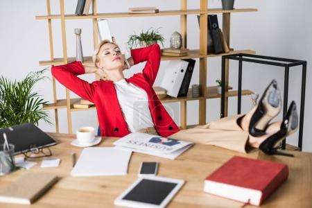 Photo for Attractive businesswoman resting at workplace in office - Royalty Free Image