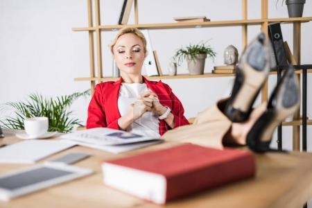 attractive businesswoman resting at workplace in office