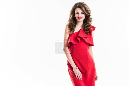 attractive stylish girl in red dress standing and looking at camera isolated on white