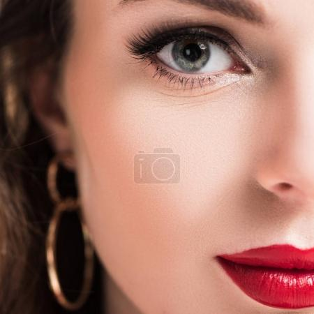 cropped image of beautiful girl with makeup and red lips