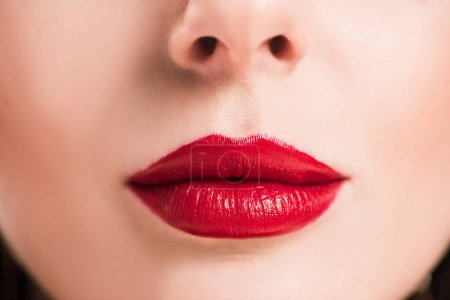 cropped image of woman with red lips and clean skin